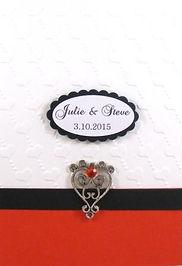 Wedding Invitation –White embossed background, red panel, black trim & silver embellishment