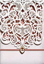 This beautiful White laser cut lace pocket has pink trim and a gold and white heart embellishment, The invitation insert is printed on the same metallic pink paper creating a gorgeous backing for the lace detail - Wedding Invitations Hand Made By Jules