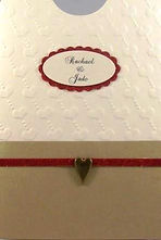 Wedding Invitation –Cream embossed background, gold panel, red trim & gold heart brad - Rachael
