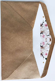 Here's a rustic envelope with a pretty floral envelope insert to add that wow factor when opening your invitation - Hand Made ByJules