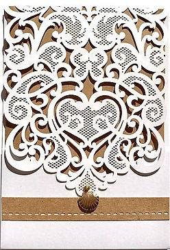 This beautiful White laser cut lace pocket has a rsutic trim and a gold shell embellishment, The invitation insert is printed on the same metallic pink paper creating a gorgeous backing for the lace detail - Wedding Invitations - Hand Made By Jules