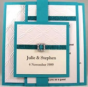 Wedding Invitation - Flat Card Group - White embossed on emerald with silver buckle