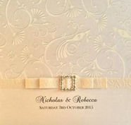 Wedding Invitation - Cream chinoiserie paper with folded paper ribbon & diamonte buckle