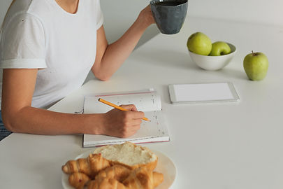 close-up-woman-planning-her-day-keeps-grey-cup-with-some-liquid.jpg