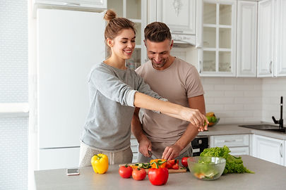 portrait-cheerful-loving-couple-cooking-salad-together.jpg