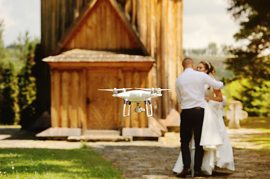 dron filming a wedding couple by the ool