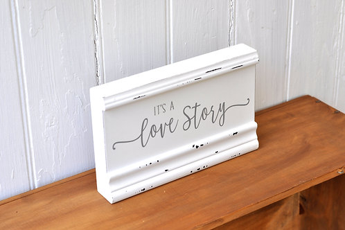 """White and Grey """"Love Story"""" Sign"""