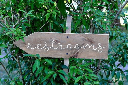 Restrooms Arrow Sign