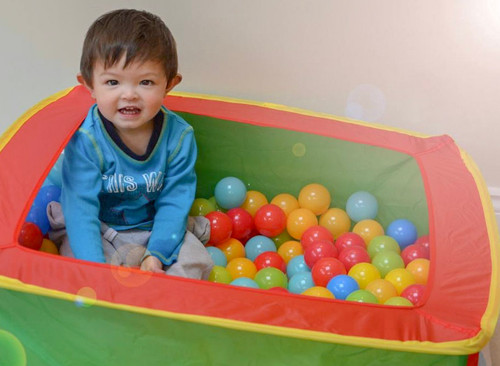 Natalia Radcliffe - Portrait Photography - Toddler In Ballpit
