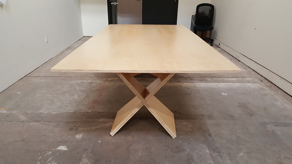The finished table is made from 2 1/2 sheets of plywood, costing $140 total.