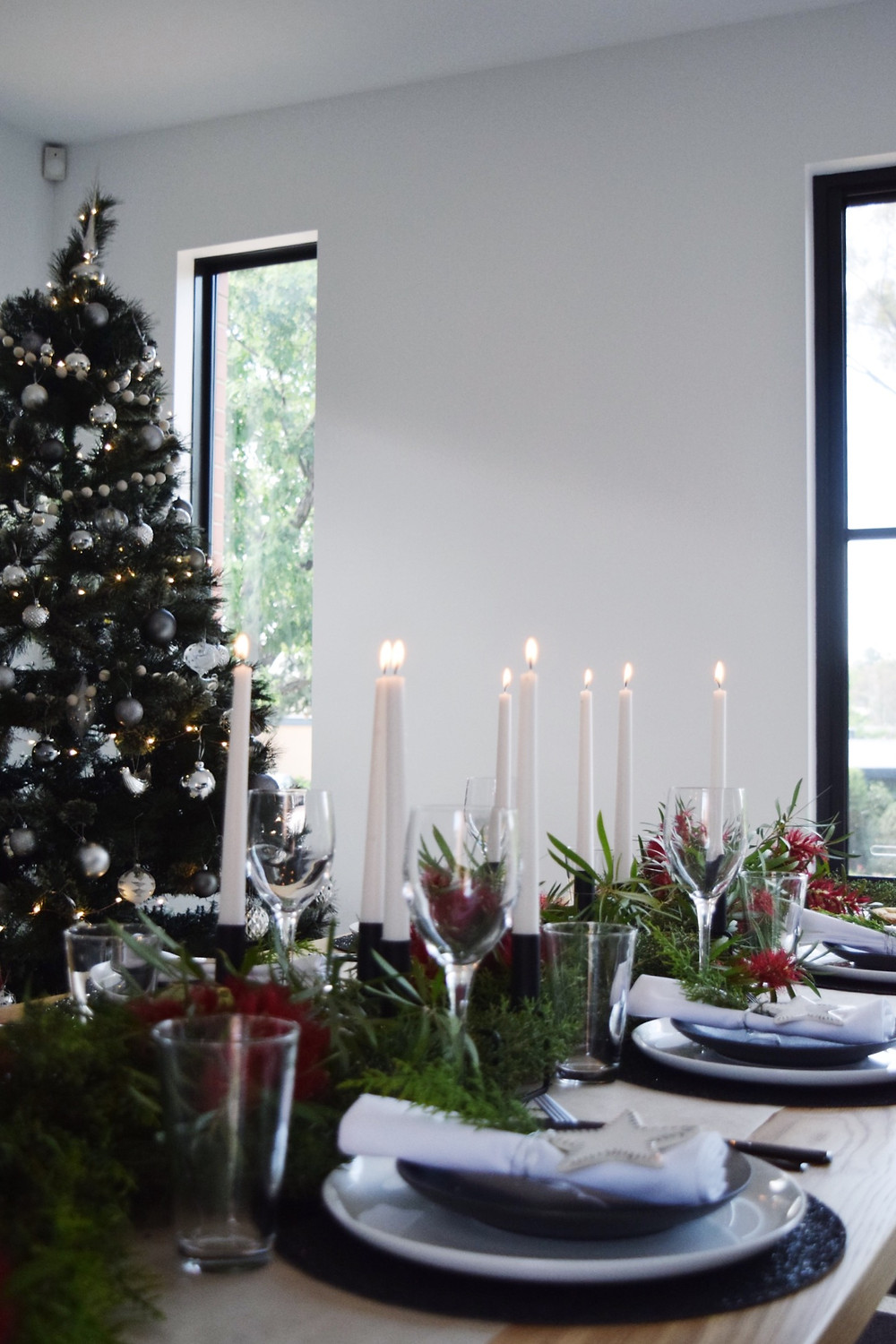 Black and white contrasting Christmas table settings with native fauna table pieces
