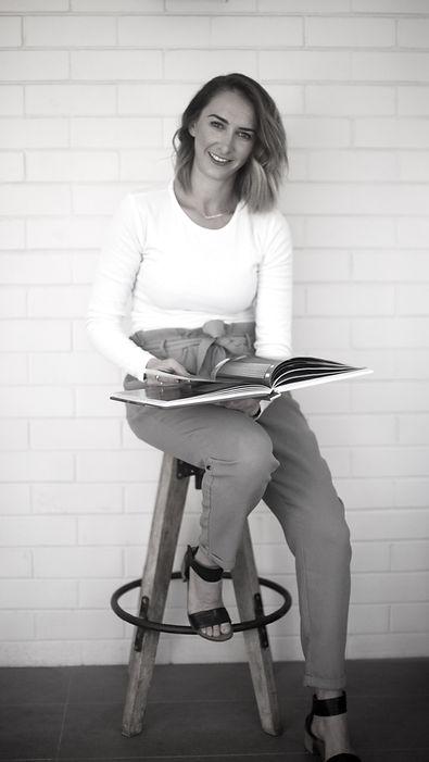 Profile photo sitting on a stool