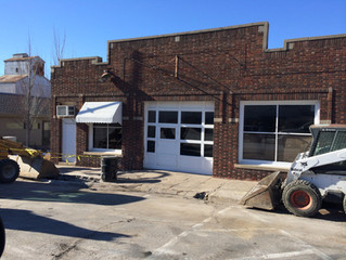 New garage door and front windows!