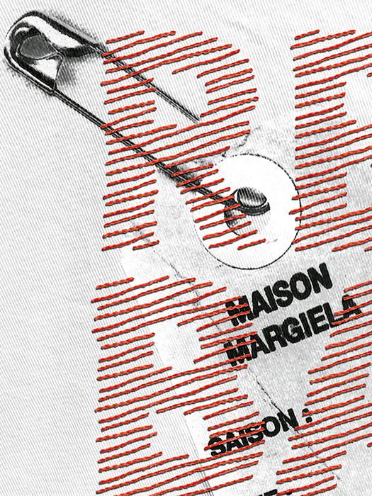 Detalle de la ilustración, puntadas de hilo diseñando la tipografía.
