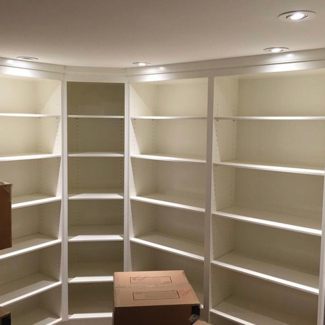 Custom built in shelving with a sprayed paint finish.