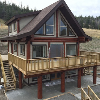 Stained logs on this newly built vaction home.