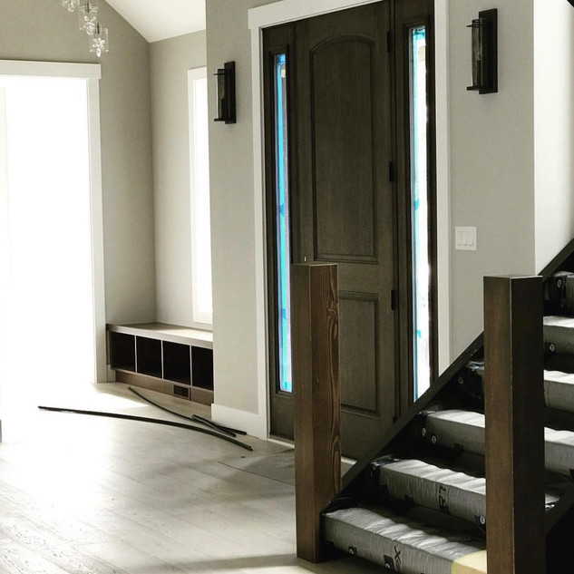 Gel stained fiber glass door and stained and varnished railing.