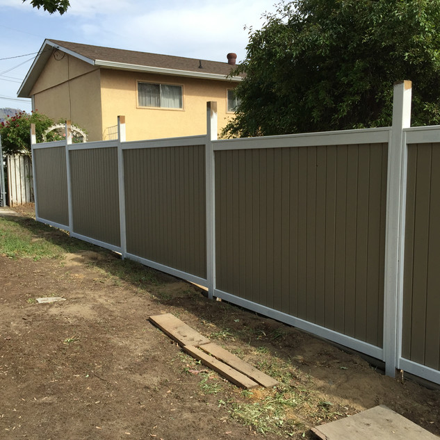 A 2 tone fence coated with solid stain.