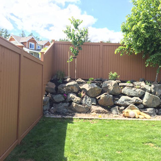 Fence painted with solid stain.