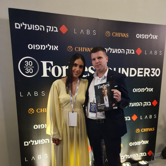 Maya and her husband in Forbes 30Under30 event