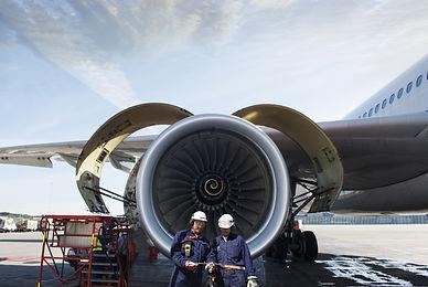 airplane mechanics and giant jet engine repair.jpg
