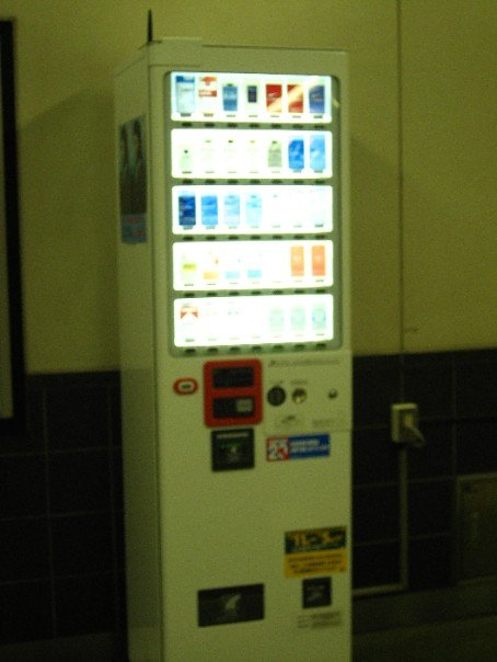 cigarette vending machines -- something you'll never see in the US.jpg  the machines also vend beer