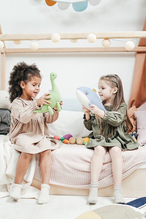 photo-of-two-girls-playing-with-stuffed-
