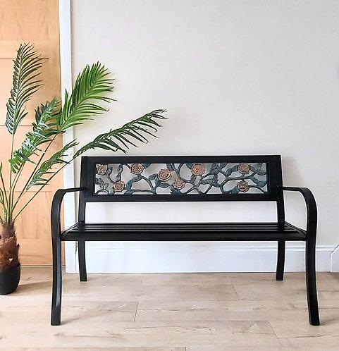 Garden bench with floral design