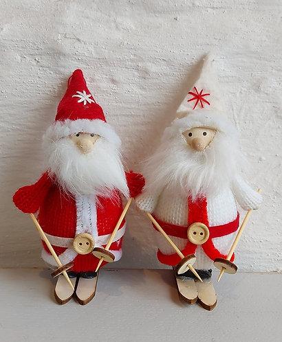 Set of two fabric Santas on skis