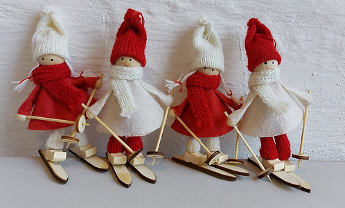 Set of four fabric children on skis