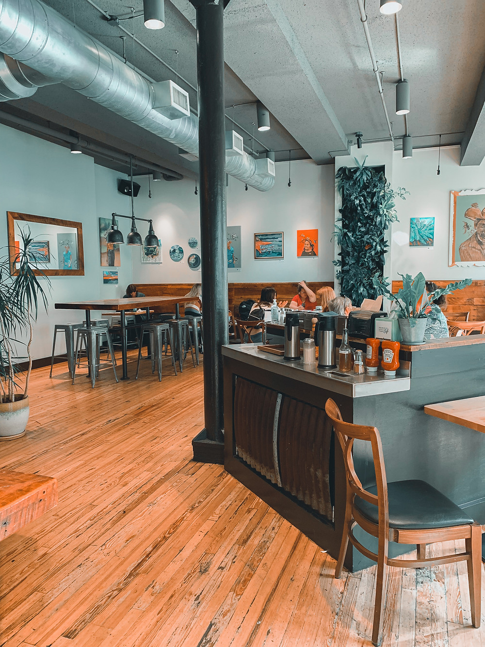 Prince Street Cafe, cafe dining room, wood chair with black seat, counter, wood floors, white walls, tables