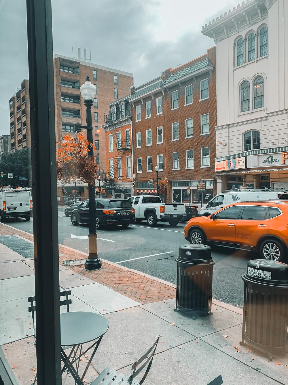 Downtown Lancaster, brick buildings, city street, cars in street, sidewalk, high rise building, street light, trash cans on street