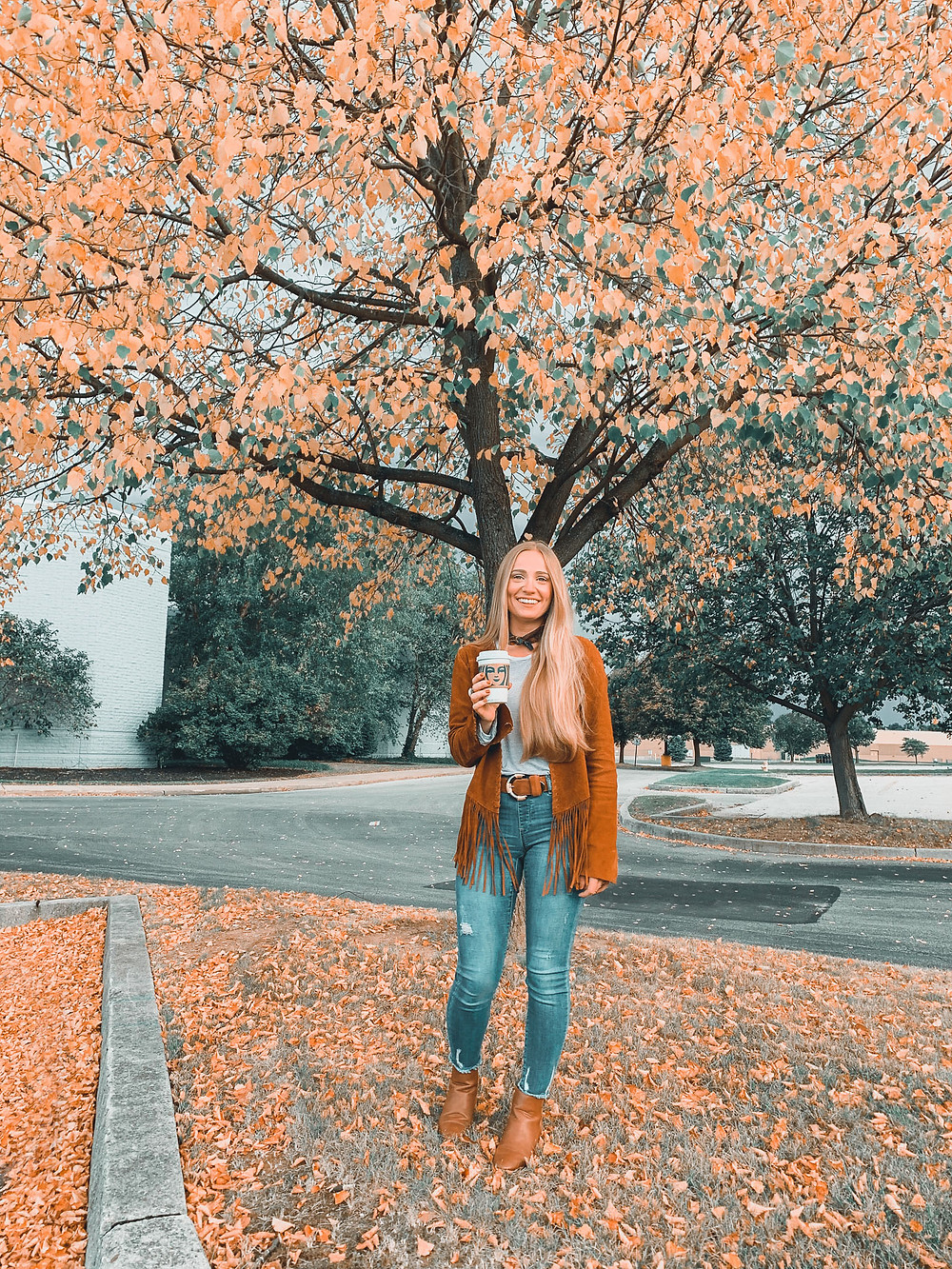 Blonde hair, fall, fall leaves, changing leaves, jeans, fringe suede jacket, scarf, parking lot, fall scene, boots