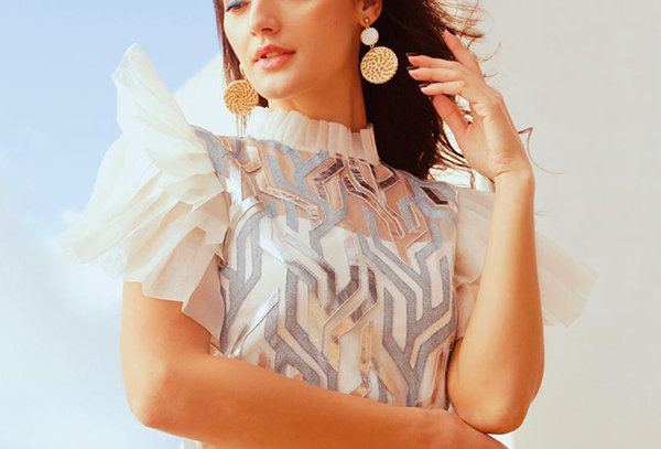 SPARKS Organza Flared Dress with metallic appliqué and pleated sleeves.