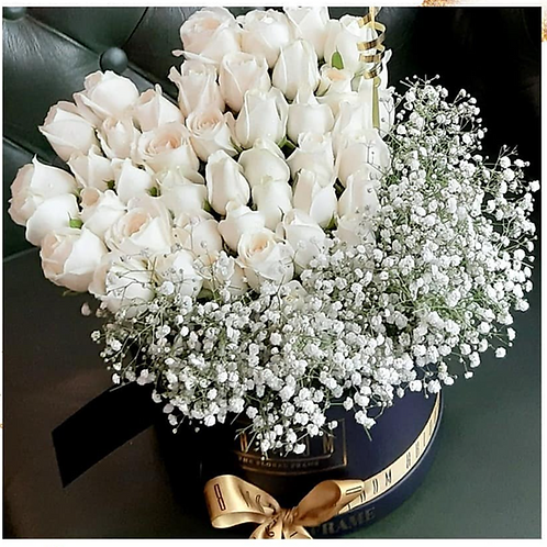 Heart White roses in a black bucket