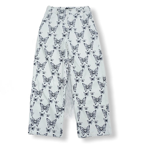 White trousers with black butterfly