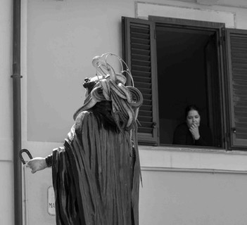 """At midday the procession begins. The """"serpari"""" place their snakes on the wooden statue of San Domenico after it was taken out of the church."""