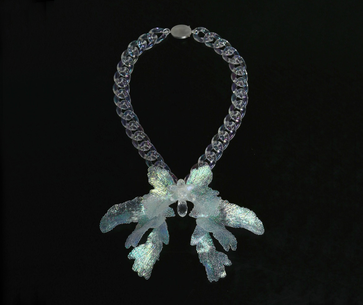 Necklace by Carina Shostary.