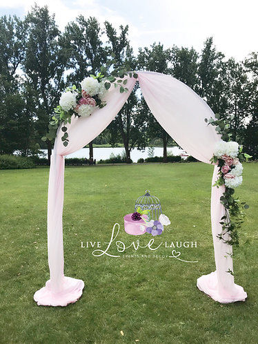 Beautiful Floral Arch with Pink Fabric Draping