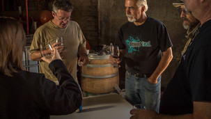 Winery partners and friends, blending and tasting wine