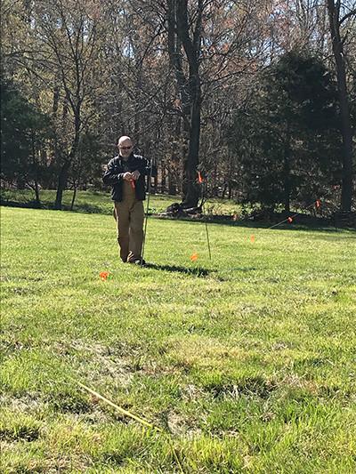 Aaron measuring out field.jpg