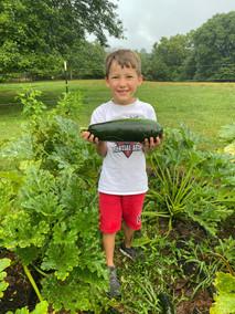 A boy with a Zucchini