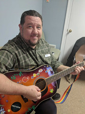 Jim-with-guitar--HOME-page.jpg