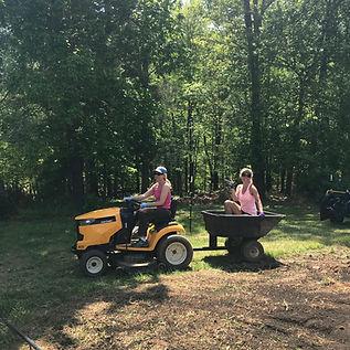 Ralanta and Kelly on the mower.jpeg