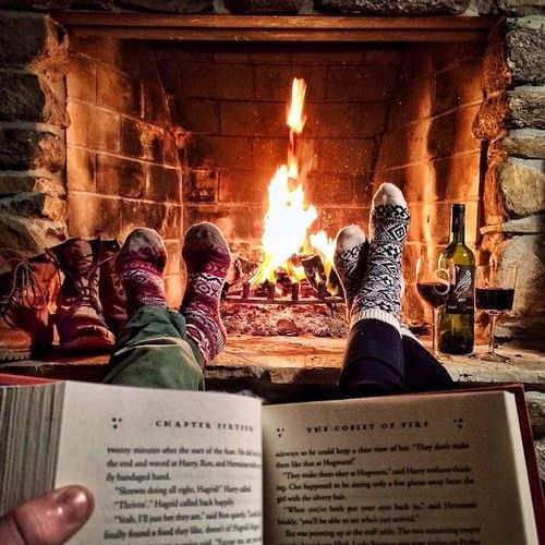 reading a physical book in front of the fire