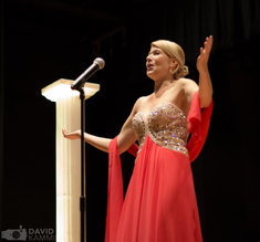 Corinne Meadors singing at the Equality International Film Festival