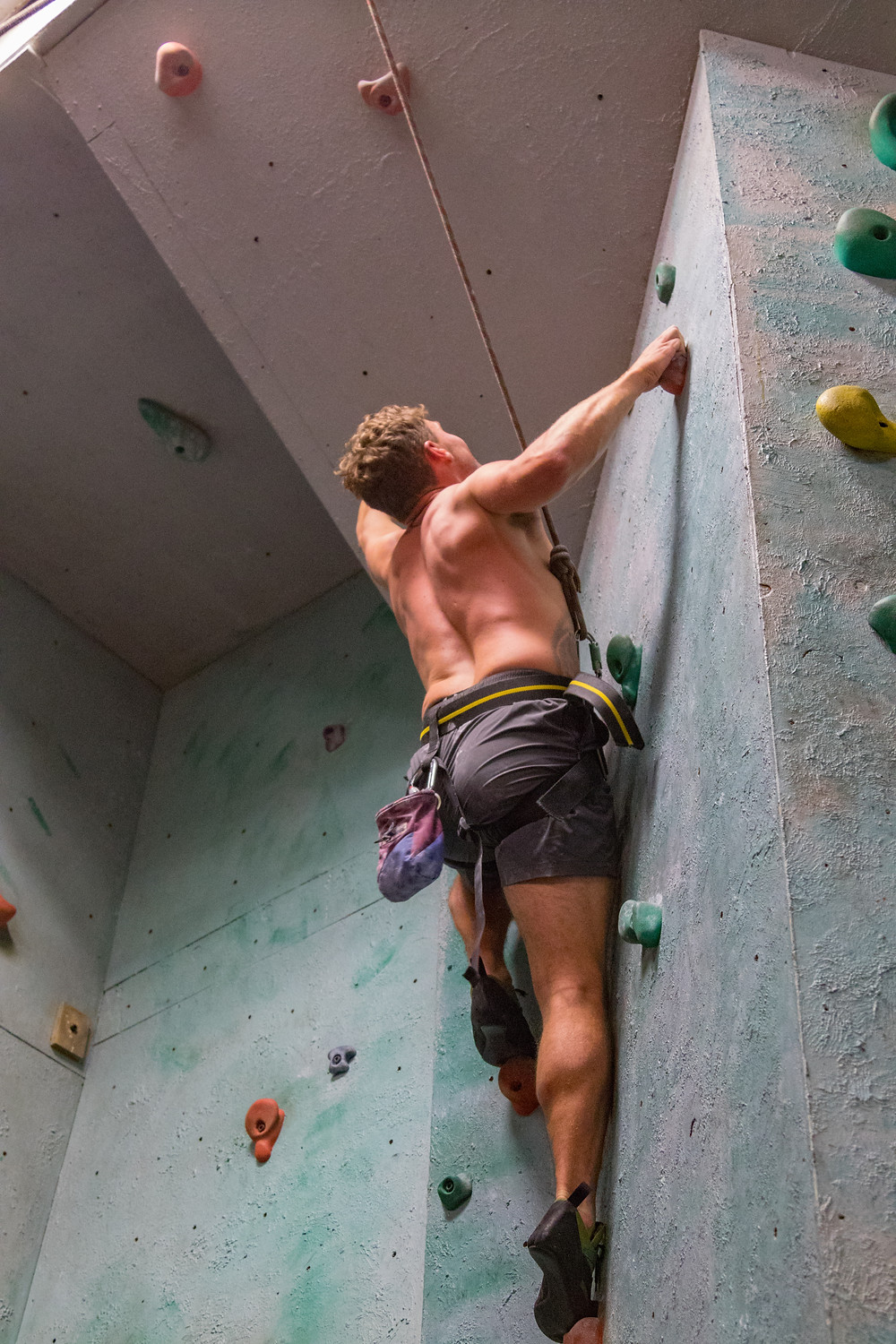 Attempting some of the climbs at the indoor climbing wall!
