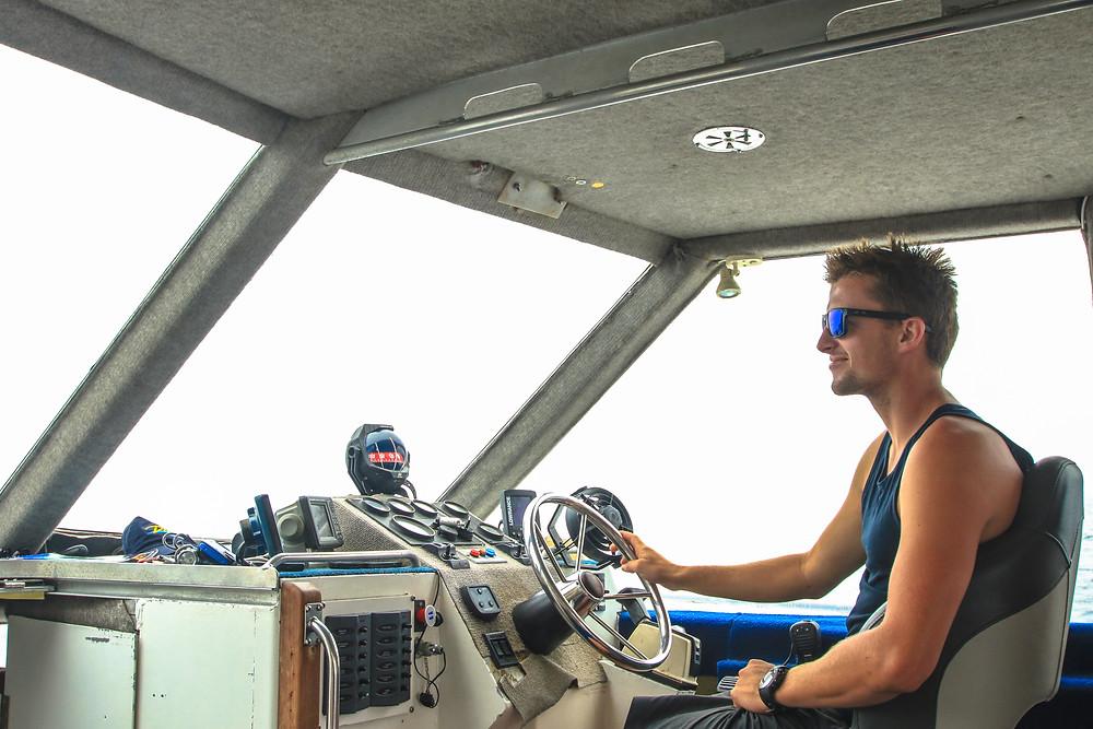 Skipper Josh Woolf at the wheel