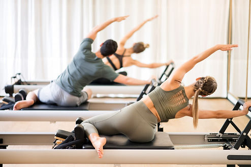 group-people-doing-mermaid-pilates-exerc