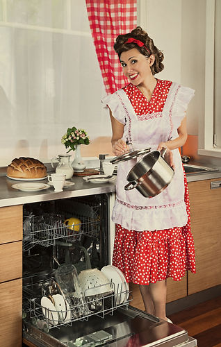 Housewife loads the dishes in the dishwasher. 1950s style post processing emulation.jpg
